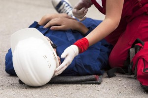 injured-man-in-white-hard-hat-on-ground